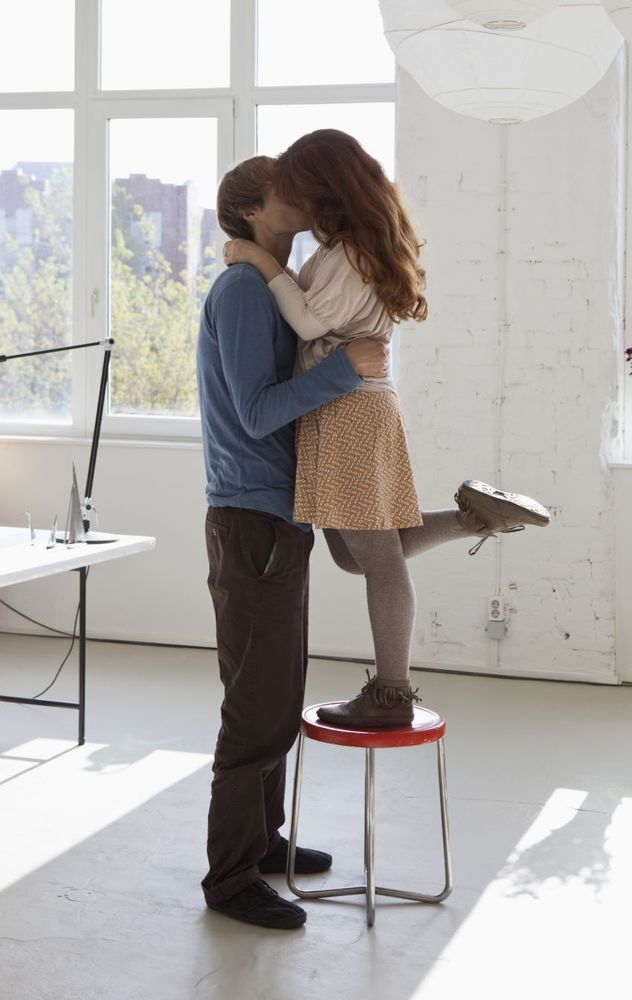 o-WOMAN-ON-STOOL-TO-KISS-TALL-MAN-facebook