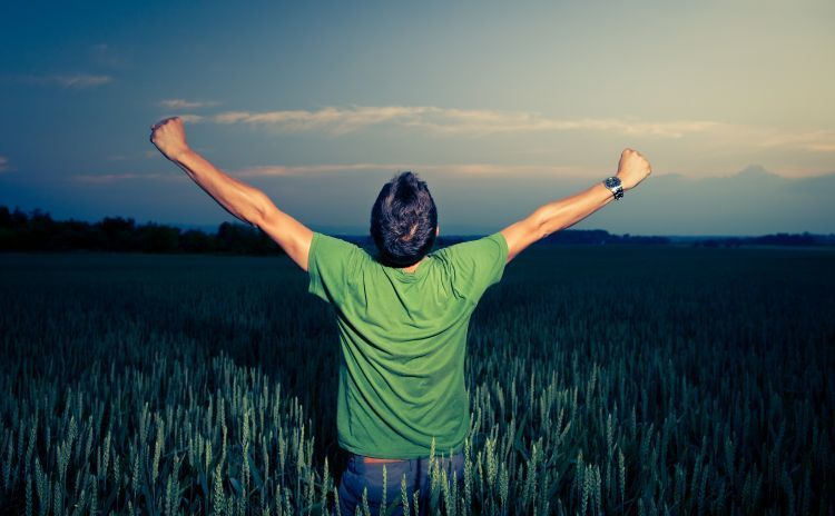 Young man enjoying his freedom/rejoicing from his success in the
