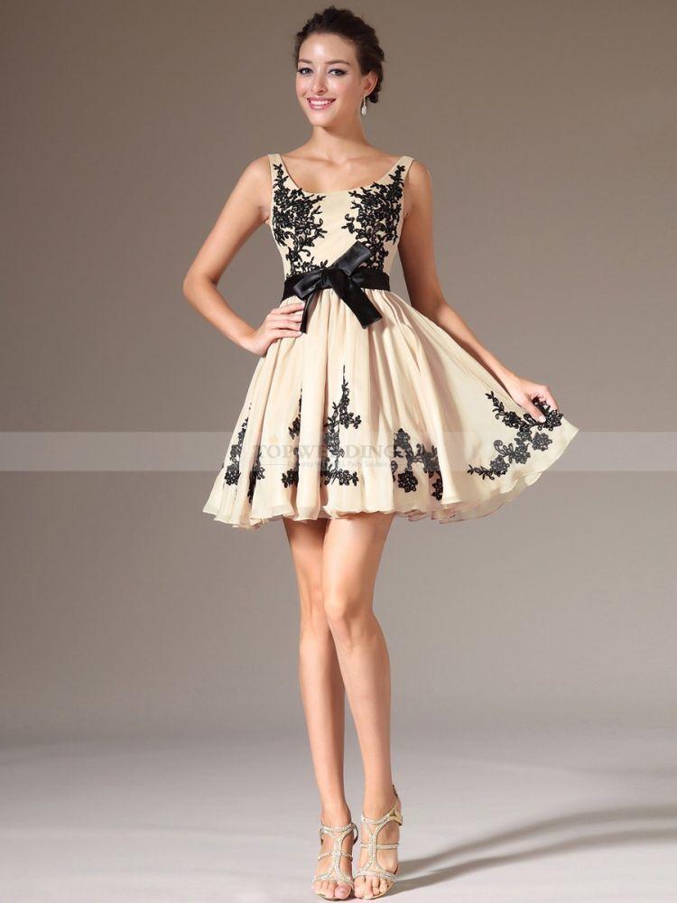 Dress warna krem dan pola bunga dan pita hitam