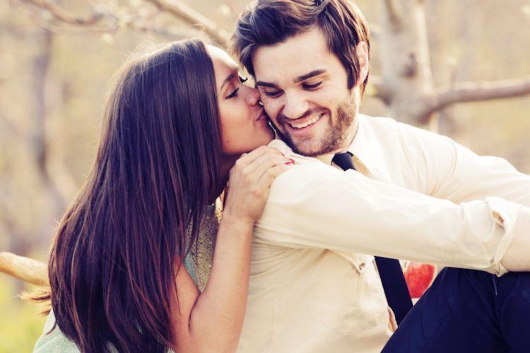 _uploads_52-engaged-couple-kiss-cheek-smile-sweet