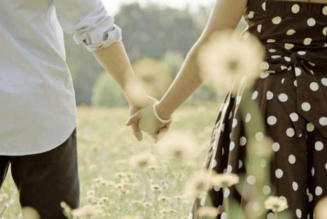 couple in love holding hands together