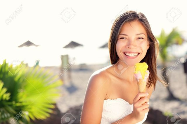 Woman eating ice cream outside