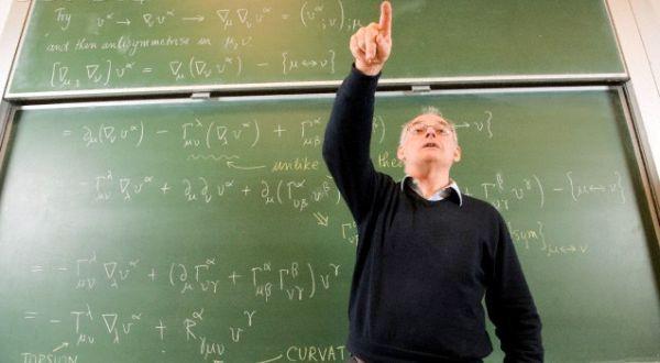 Professor teaching in front of blackboard --- Image by © Peter M. Fisher/Corbis