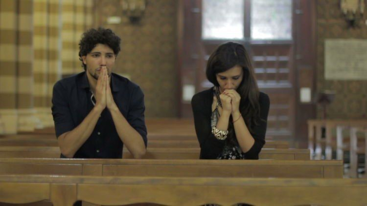 stock-footage-couple-desperate-prayer-in-a-church