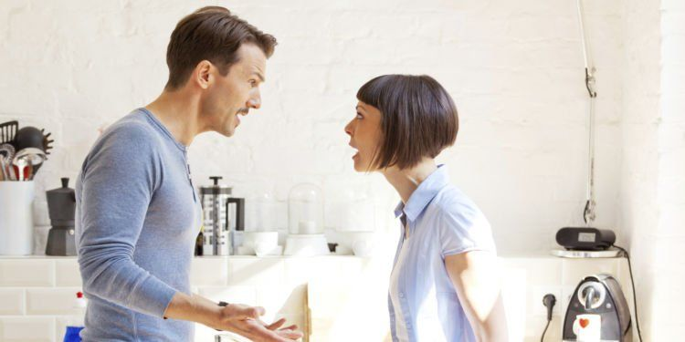 Couple having a discussion in the kitchen
