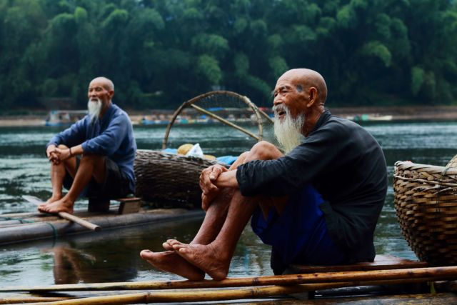 chatting with two men on riverbank