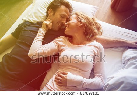 couple-lover-laying-on-bed-happiness