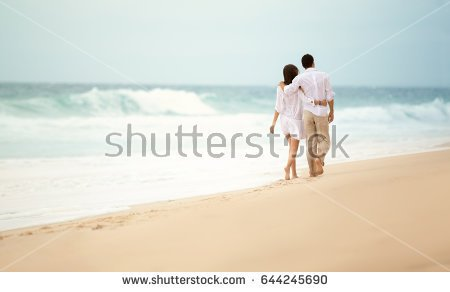 back-view-romantic-couple-walking-beach